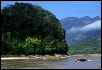 Slow passenger boat near Pak Ou. Mekong river, Laos (color)