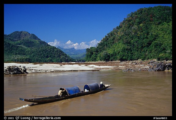 Narrow live-in boat. Mekong river, Laos (color)