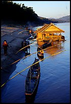 Boats and stilt house of a small hamlet. Mekong river, Laos