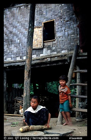 Children near stilt house of a small hamlet. Mekong river, Laos