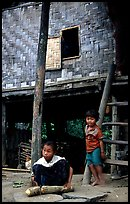Children near stilt house of a small hamlet. Mekong river, Laos ( color)