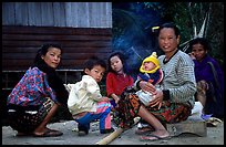 Group of women and children in a small hamlet. Mekong river, Laos