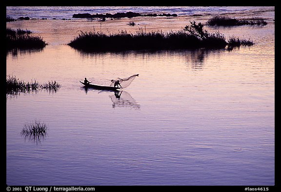 Fisherman casts net at sunset in Huay Xai. Laos