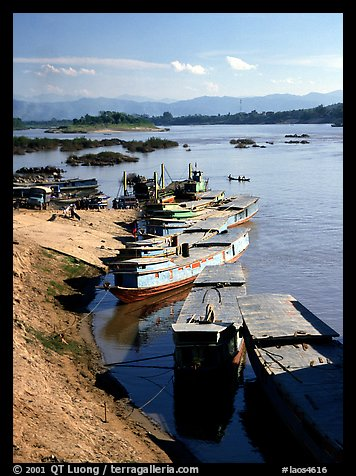 Slow passenger boats in Huay Xai. Mekong river, Laos (color)