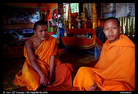 Buddhist novice monks inside temple. Luang Prabang, Laos