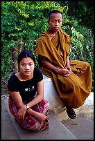 Buddhist novice monk and his sister. Luang Prabang, Laos (color)