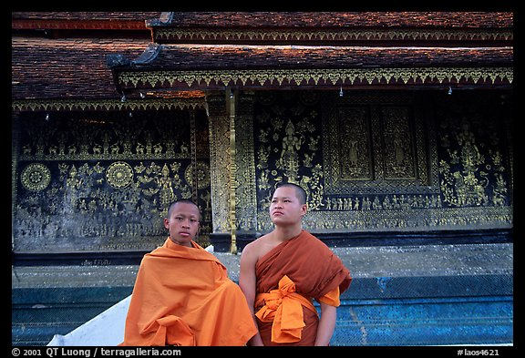 Two buddhist novice monks at Wat Xieng Thong. Luang Prabang, Laos