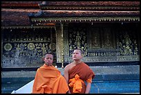 Two buddhist novice monks at Wat Xieng Thong. Luang Prabang, Laos (color)