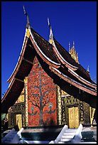 Rear of the Sim of Wat Xieng Thong with mosaic of the tree of life. Luang Prabang, Laos