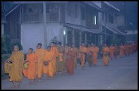 Morning alms procession of buddhist monks. Luang Prabang, Laos (color)
