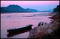 Dusk on the Mekong river framed by coconut trees. Luang Prabang, Laos ( color)