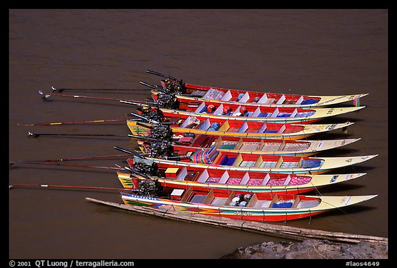 Fast boats on the Mekong river. With their 40 HPW Toyota engines, they cruise at 50 mph on the river. Mekong river, Laos (color)