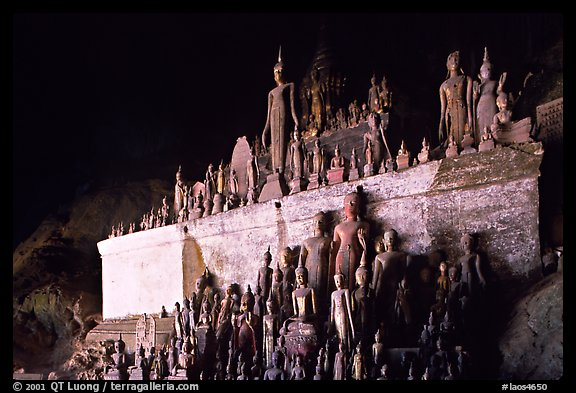 Buddha statues left by pilgrims in Pak Ou caves. Laos (color)