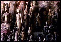 Lao style Buddha sculptures assembled over the centuries by local people, Pak Ou. Laos ( color)