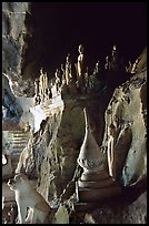 Buddhist statues left by pilgrims, lower Pak Ou cave. Laos (color)