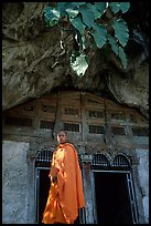Novice Buddhist monk at entrance of lower Pak Ou cave. Laos