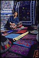 Young woman sells crafts on market. Luang Prabang, Laos (color)