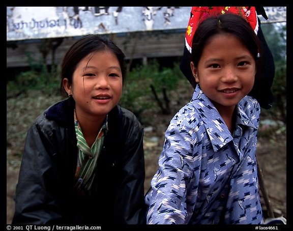 Two young girls at the market. Luang Prabang, Laos