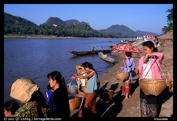 Women on the banks of the Mekong river. Luang Prabang, Laos