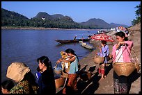 Women on the banks of the Mekong river. Luang Prabang, Laos ( color)