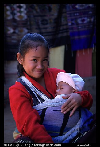 Girl and baby, Ban Xang Hai. Laos (color)