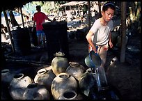 Making of the Lao Lao, strong local liquor in Ban Xang Hai village. Laos ( color)