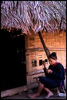 Woman of the Lao Huay tribe in front of her hut,  Ban Nam Sang village. Laos (color)