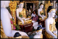 Surrounded by Buddha statues, Shwedagon Paya. Yangon, Myanmar (color)