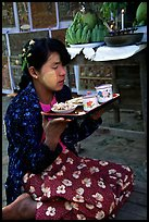 Burmese woman offering food. Bagan, Myanmar