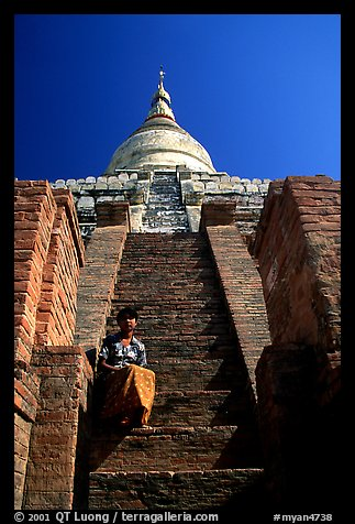 On steps of Shwesandaw Paya's upper terraces. Bagan, Myanmar