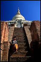On steps of Shwesandaw Paya's upper terraces. Bagan, Myanmar (color)