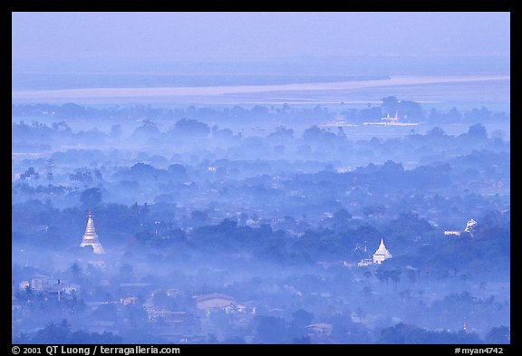 View from the hill through dawn mist. Mandalay, Myanmar