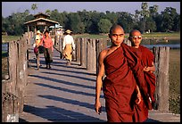 On the two century old U Bein bridge, Amarapura. Mandalay, Myanmar (color)