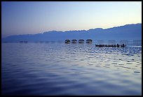 Long boat,  stilts huts, and mountains, sunrise. Inle Lake, Myanmar ( color)