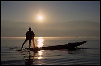 Intha fisherman, sunrise. Inle Lake, Myanmar (color)