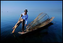 Intha fisherman on duggout with net. Inle Lake, Myanmar (color)