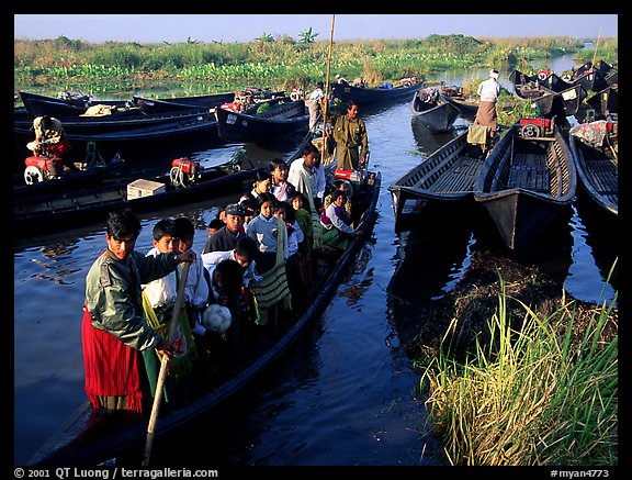 Children commuting to school on small boat. Inle Lake, Myanmar (color)
