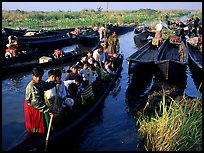 Children commuting to school on small boat. Inle Lake, Myanmar ( color)