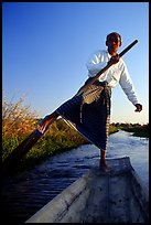 Intha man demonstrating leg-rowing. Inle Lake, Myanmar (color)