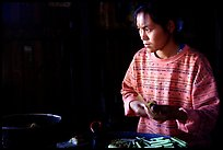 Woman Making cheerots. Inle Lake, Myanmar (color)