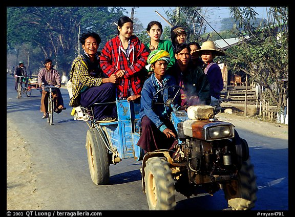 Riding tractor on road near Swwenyaung. Shan state, Myanmar