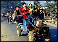 Riding tractor on road near Swwenyaung. Shan state, Myanmar (color)