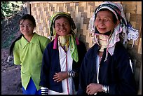 Three generations of Padaung women	along hut. Shan state, Myanmar ( color)