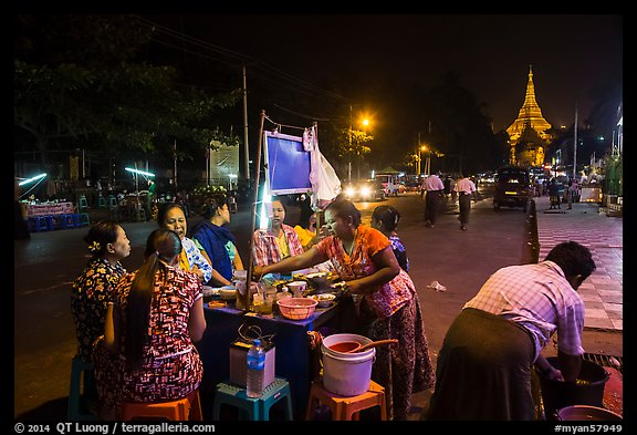 Streat food served at night, Shwedagon Pagoda in background. Yangon, Myanmar (color)
