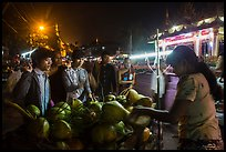 Customers waiting for coconuts to be cut on the street. Yangon, Myanmar ( color)
