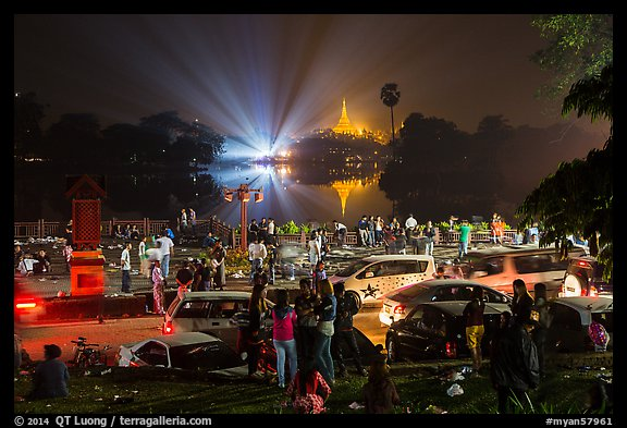 Shores of Kandawgyi with revelers on 2014 New Year night. Yangon, Myanmar (color)