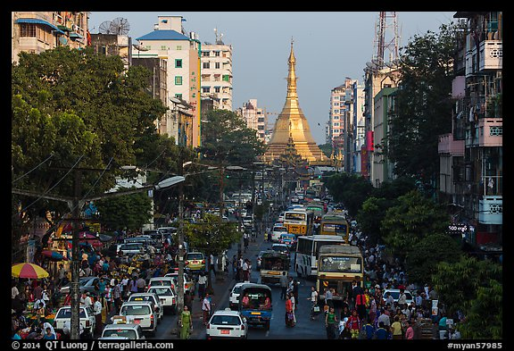 Street with busy traffic leading to Sule Pagoda. Yangon, Myanmar (color)