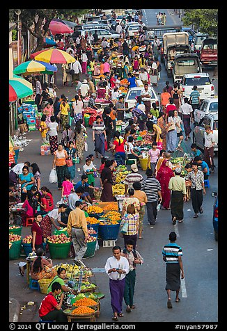 Street crowd from above with fruit and vegetable sellers. Yangon, Myanmar (color)