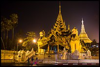 Southern gate guarded by two leogryphs and Main Stupa at night, Shwedagon Pagoda. Yangon, Myanmar ( color)