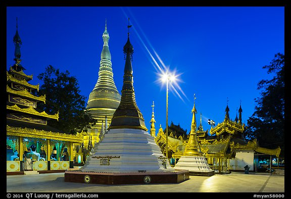 Shrines, stupas, and Main Stupa at dawn, Shwedagon Pagoda. Yangon, Myanmar (color)